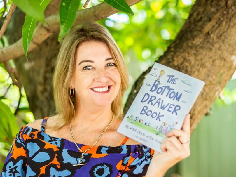 Lisa Herbert holds The Bottom Drawer Book: an after death action plan.