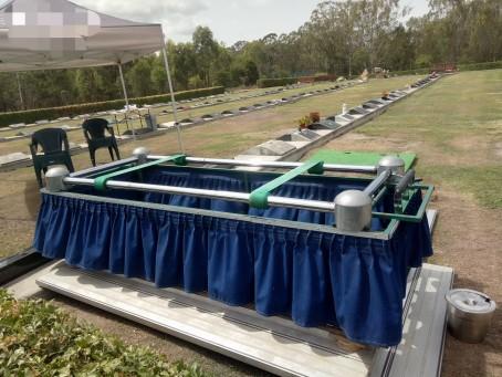 A casket lowering device.